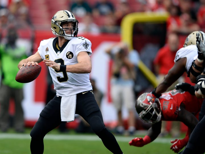 New Orleans Saints quarterback Drew Brees (9) throws a pass against the Tampa Bay Buccaneers during the first half of an NFL football game Sunday, Dec. 9, 2018, in Tampa, Fla. (AP Photo/Jason Behnken)