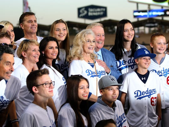 Vin Scully, center, poses for photographers with his wife, Sandi Scully, and other family members, on the field at Dodger Stadium before a game between the Los Angeles Dodgers and the Arizona Diamondbacks on Sept. 23, 2015.