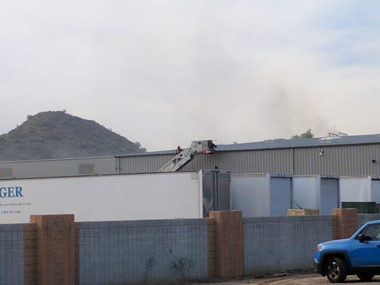 Phoenix firefighters battled a warehouse fire on Jan. 11, 2017. When crews arrived they saw black smoke coming from vents atop the building.