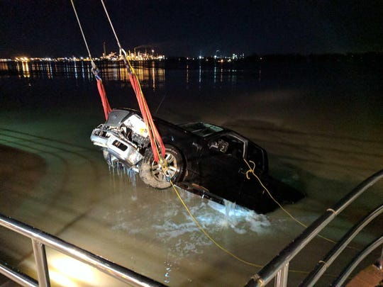 A pickup truck is removed from the St. Clair River early Saturday.