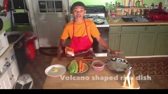 Benjamin with his volcano-shaped rice dish in his step-by-step