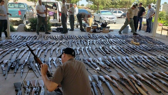An undated handout photo made available by the Los Angeles County Sheriff's Department on  June 19, 2018 shows seized firearms.