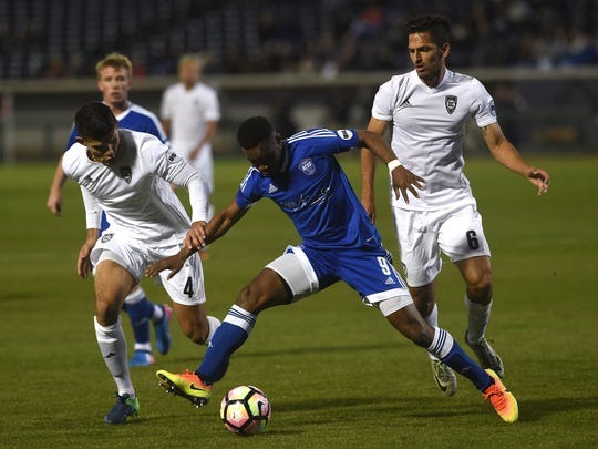 Reno 1868 FC's Dane Kelly (9) fights for a loose ball while taking on Orange County SC during the first regular season soccer game at Greater Nevada Field in Reno on March 25, 2017.