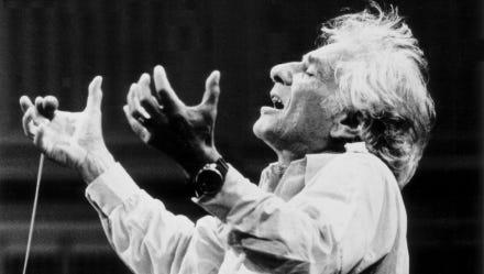 Leonard Bernstein leads an orchestra.