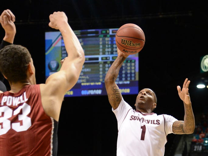 March 13, 2014 -  Arizona State Sun Devils guard Jahii Carson (1) shoots against Stanford Cardinal forward Dwight Powell (33) during the first half in the quarterfinals of the Pac-12 Conference tournament at MGM Grand Garden Arena.