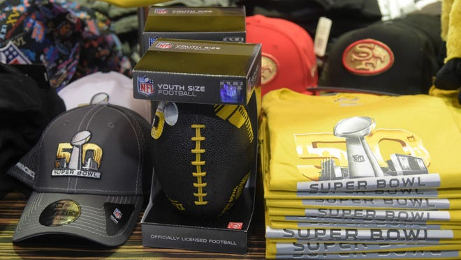 Super Bowl 50 merchandise including T-shirts, souvenir footballs and beanies on sale at the Oakland International Airport.