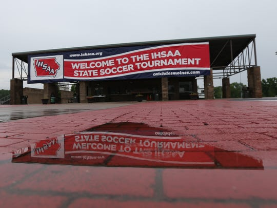 Water pools at the Cownie Soccer Complex after the Iowa high school state soccer finals were postponed in 2014.