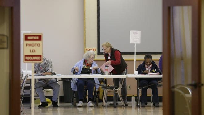 Poll workers at the First United Methodist Church polling station work during Tuesday's election.