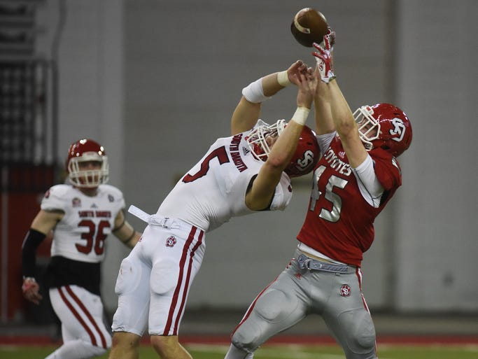 USD white team's Brian Woodward breaks up a pass intended
