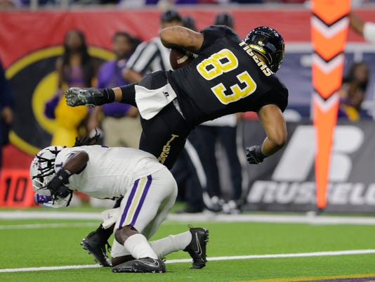 Grambling State tight end Jordan Jones (83) catches a pass for a touchdown in the second quarter while defended by Alcorn State defensive back Deago Sama (1) during the Southwestern Athletic Conference championship football game in Houston, Texas, Saturday, Dec. 2, 2017. (Tim Warner/Houston Chronicle via AP)