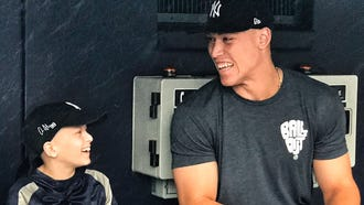 Luca Iacono, of Middletown, chats with Aaron Judge in the dugout at Yankee Stadium. Iacono, a cancer survivor, spent a day with the Yankees through the Make-A-Wish Foundation.