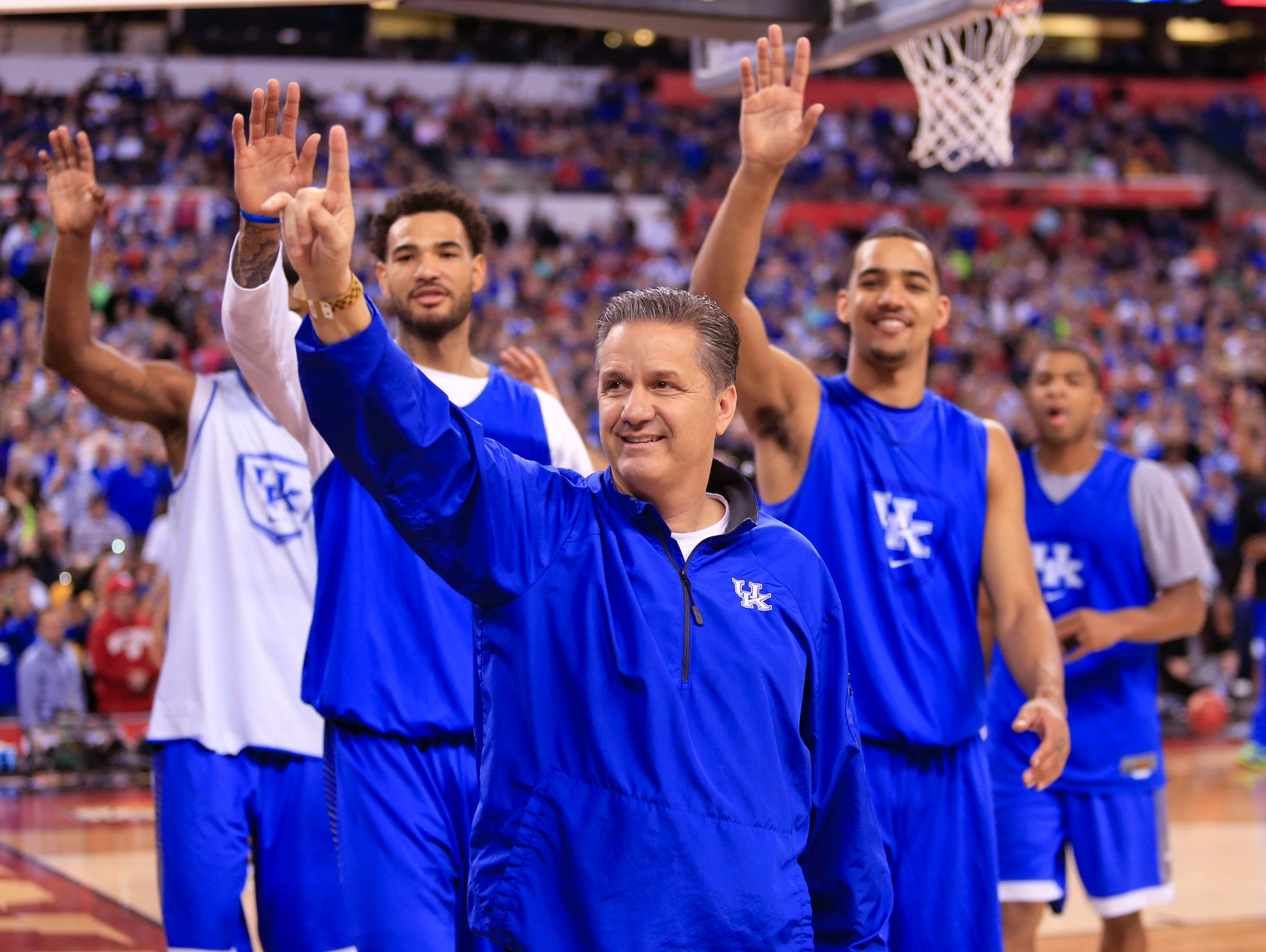 Kentucky head coach John Calipari and players wave to fans at the end of practice Friday afternoon at Lucas Oil Stadium. By Matt Stone, The C-J April 3, 2015.