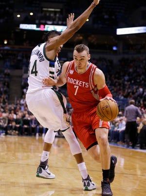 Houston's Sam Dekker drives against the Bucks' Giannis Antetokounmpo during their game Monday night.