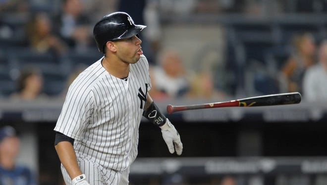 New York Yankees' Gary Sanchez flips his bat after hitting a home run during the third inning of a baseball game against the Tampa Bay Rays on Friday, Sept. 9, 2016, at Yankee Stadium in New York.