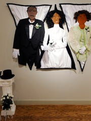 Portrait quilts by Riche' Richardson are displayed at the Rosa Parks Museum in Montgomery, Ala. on Saturday January 10, 2015. These quilts represent black debutante balls.