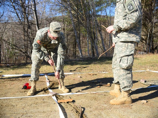 Cadets prepare a scale model of a mock deployment zone