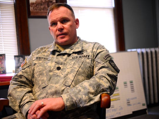 Lt. Col. Tim Knoth, commander of the UVM ROTC cadet corps, speaks in his office on April 21.