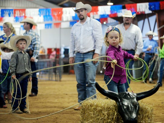 Macy Compton takes first place in the dummy roping competition during the Western Heritage Classic at the Taylor County Expo Center.