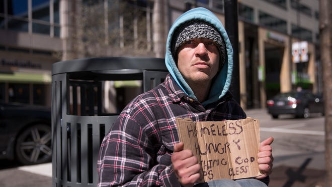 Michael, 32, has been living on the streets of downtown Cincinnati for about 12 weeks. He said he'd been laid off from his job in Ft. Thomas and fell on hard times after that. He said he'd never been homeless before and now he has the (homeless) stigma attached to him and it's hard to find a job.
