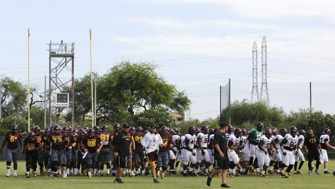 ASU's football team breaks from a huddle during practice on Thursday, Aug. 10, 2017.