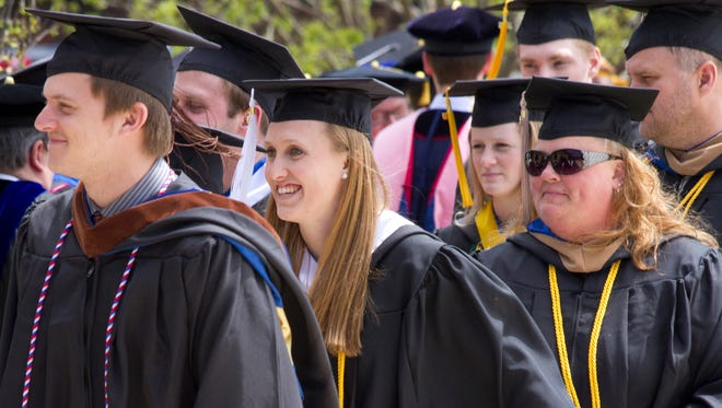 Callie Olson, center, the recipient of Lakeland's Koehler Campus Senior Award, at Lakeland College graduation on May 1, 2016 in Plymouth, WI.