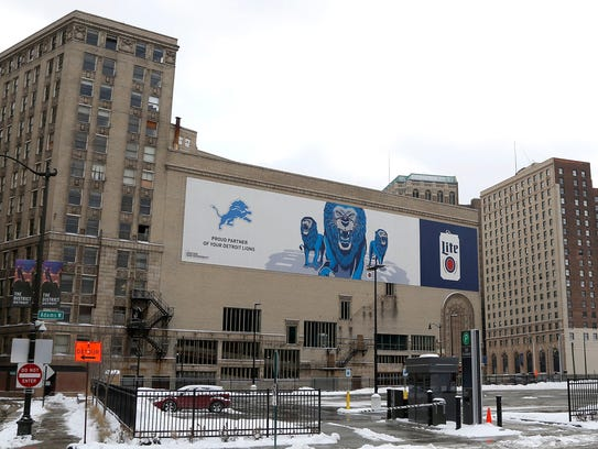 A large Detroit Lions and Miller beer sign is on the Michigan Theater on Dec. 29, 2017, in downtown Detroit.