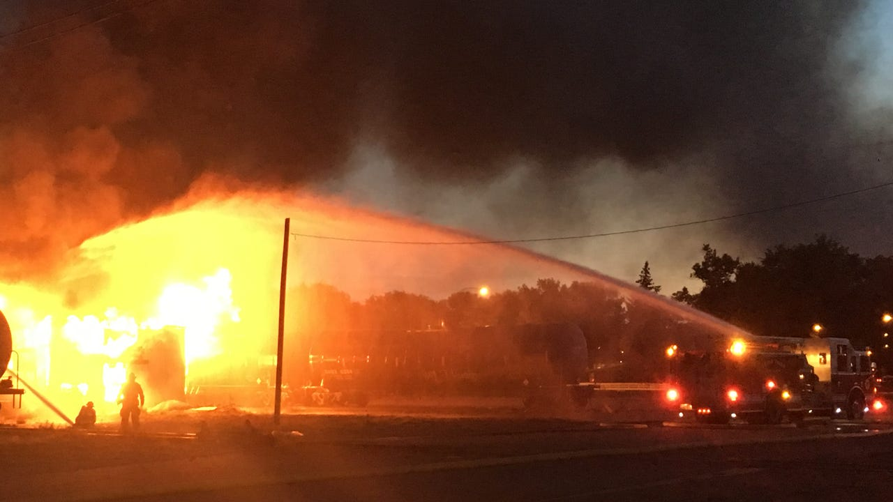 The fire is a structure fire in close proximity to tanker cars on the railway.