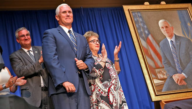 Vice President Mike Pence smiles after his Indiana Gubernatorial portrait is unveiled at the Indiana Statehouse, Friday, Aug. 11, 2017.