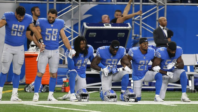 The Detroit Lions took a knee and joined arms in protest of statements made by President Donald Trump before a game against the Atlanta Falcons on Sunday, Sept. 24, 2017 at Ford Field in Detroit.