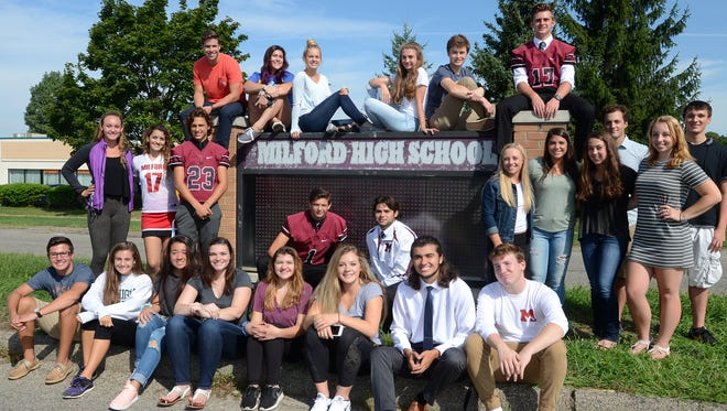 Milford High students of teacher Dave Gilbert's Leadership class gather outside the school Sept. 9 at its sign near Milford Road. The sign has been is disrepair for years and cannot display any lighted information. The class has begun fundraising efforts to have it replaced and believe it'll need about $15,000 to do so.