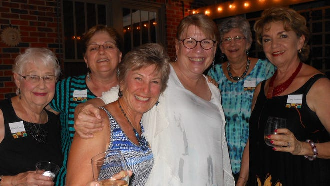 From left, Alberta Dautel, Janine Koslofsky, Carol Luehrs, Wendy Ostlund, Maureen Emerson and Ludy Sanderson, enjoyed the International Dinner Festival hosted in Cloverdale by the Newcomers Club of Montgomery.