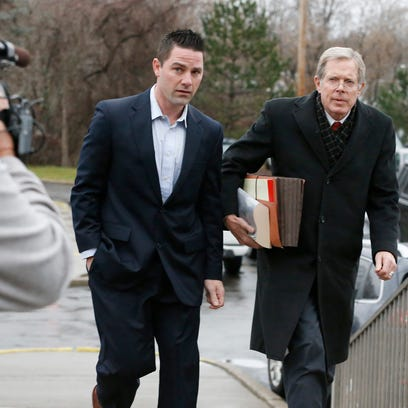 Thomas Clayton walks with his lawyer Ray Schlather