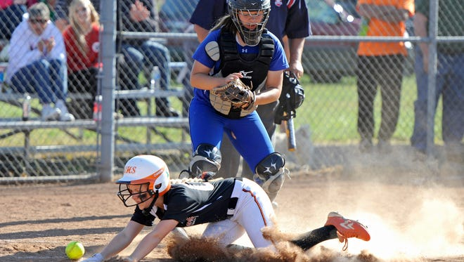 Chillicothe's Haylee Jo Large looks on as a Waverly runner slides across homeplate after the ball was knocked loose from her hand during the game at Waverly on Wednesday during the Division II Sectional Semifinals. The final score was Chillicothe 5, Waverly 15.