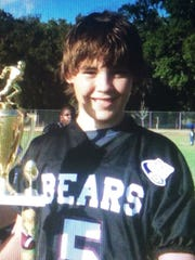 UWF quarterback Mike Beaudry as a child playing football