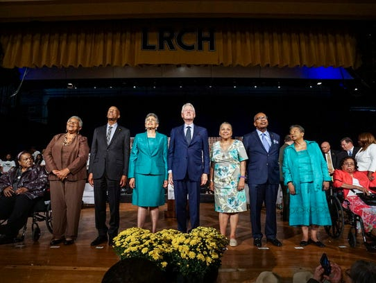 Former President Bill Clinton, center, poses for a