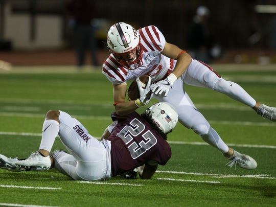 Ray's Brad Breckenridge is tackled by Flour Bluff's Kadon Luke during their District 30-5A interzone playoff game on Friday, Nov. 10, 2017, at Hornets Stadium.