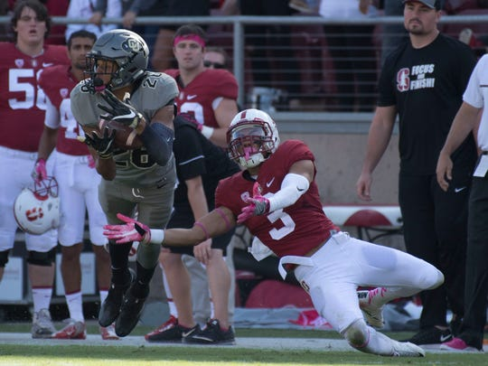 Colorado Buffaloes defensive back Isaiah Oliver (26) intercepts the ball intended for Stanford Cardinal wide receiver Michael Rector (3) during the fourth quarter at Stanford Stadium.