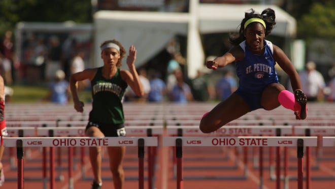 St. Peter's Alysse Wade wins the 100 hurdles during the Division III state meet Saturday at Jesse Owens Memorial Stadium.