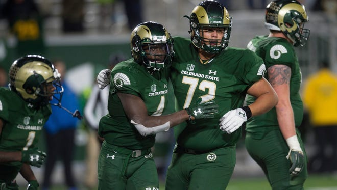 Guard Nicho Garcia, right, celebrates a touchdown with receiver Michael Gallup during CSU's 44-42 win over visiting Nevada on Oct. 14, 2017. Garcia, who started 10 games at right guard, was dismissed from the CSU football team last month, a school official said earlier this week.