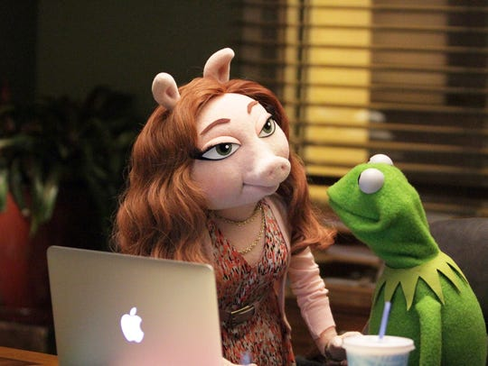 Denise, left, and Kermit the Frog engage in office