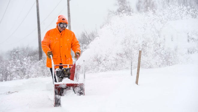 Bernard Hemond clears snow from his driveway in Williston on Thursday, February 16, 2017.