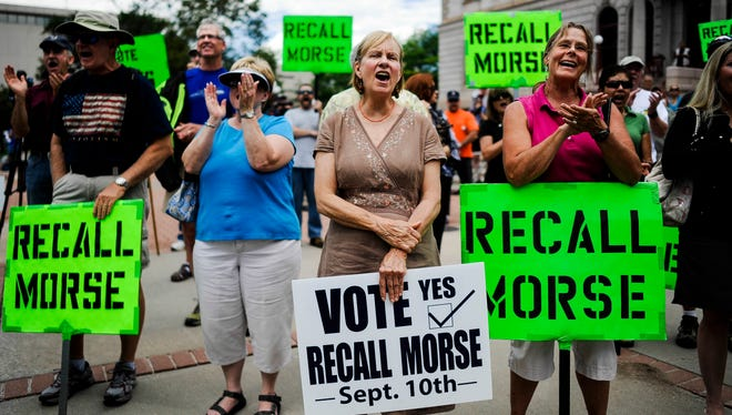 Supporters of Colorado's recall elections rally in Colorado Springs on Sept. 4.
