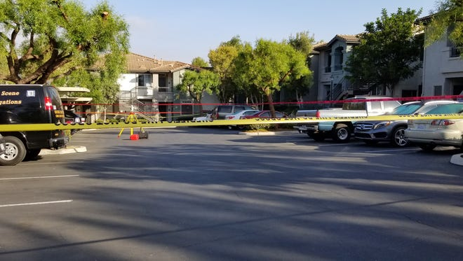 Yellow tape cordons off an area of apartments in the 5000 block of Corte Estima in Camarillo Monday morning. Camarillo police arrested a man after an hourslong standoff.