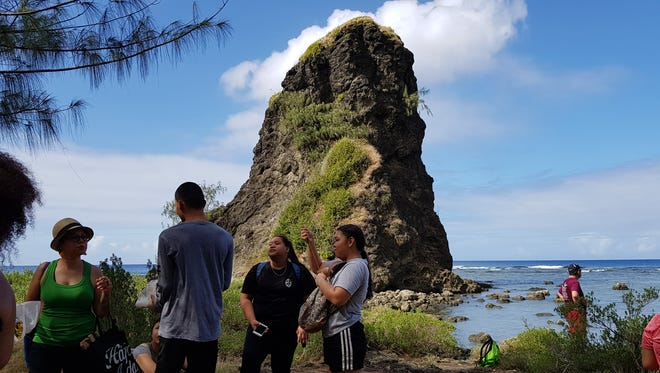 Residents attend the Lukao Fuha, a hike down to Fua Rock in Umatac, to honor the island's ancestors on Feb. 17, 2018.