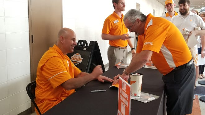 Tennessee coach Jeremy Pruitt signs autographs during UT's Big Orange Caravan in Memphis on May 15, 2018.