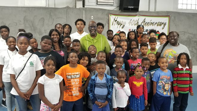 Marvis Cofield poses with some of the center's young people.