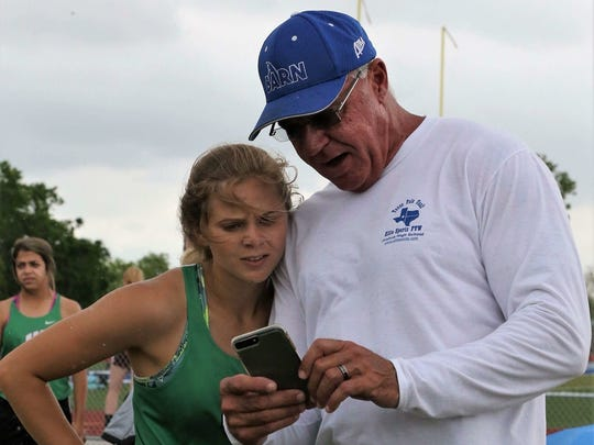 Woodsboro's Skylar Hall looks at video of a recent pole vault attempt with Kevin Hall, her father and coach of the Vault Barn club team.