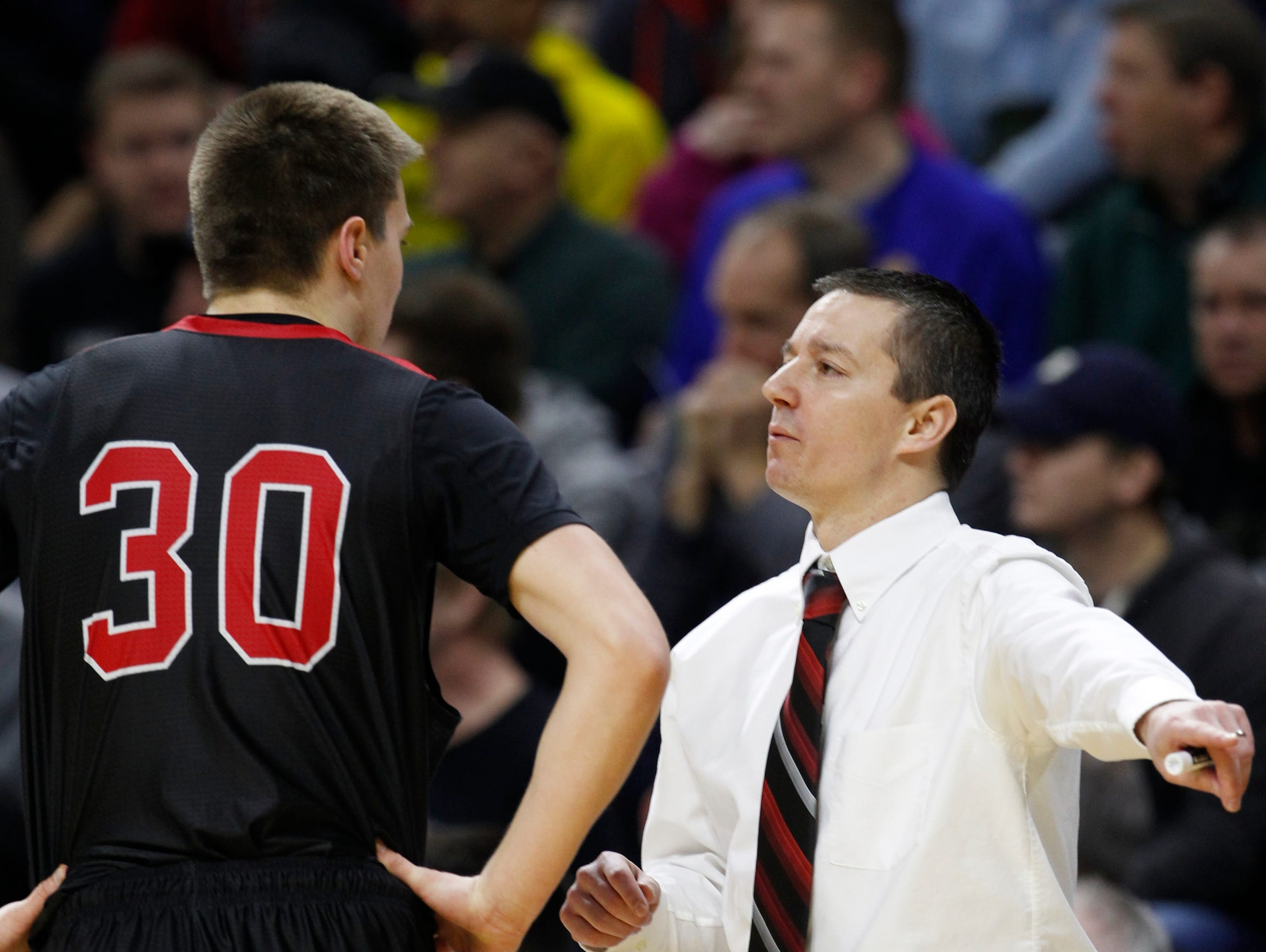 Powers North Central Jason Whitens listens to instructions from head coach Adam Mercier in the first half against Morenci in the MHSAA boys basketball Class D finals March 28, 2015 in East Lansing.