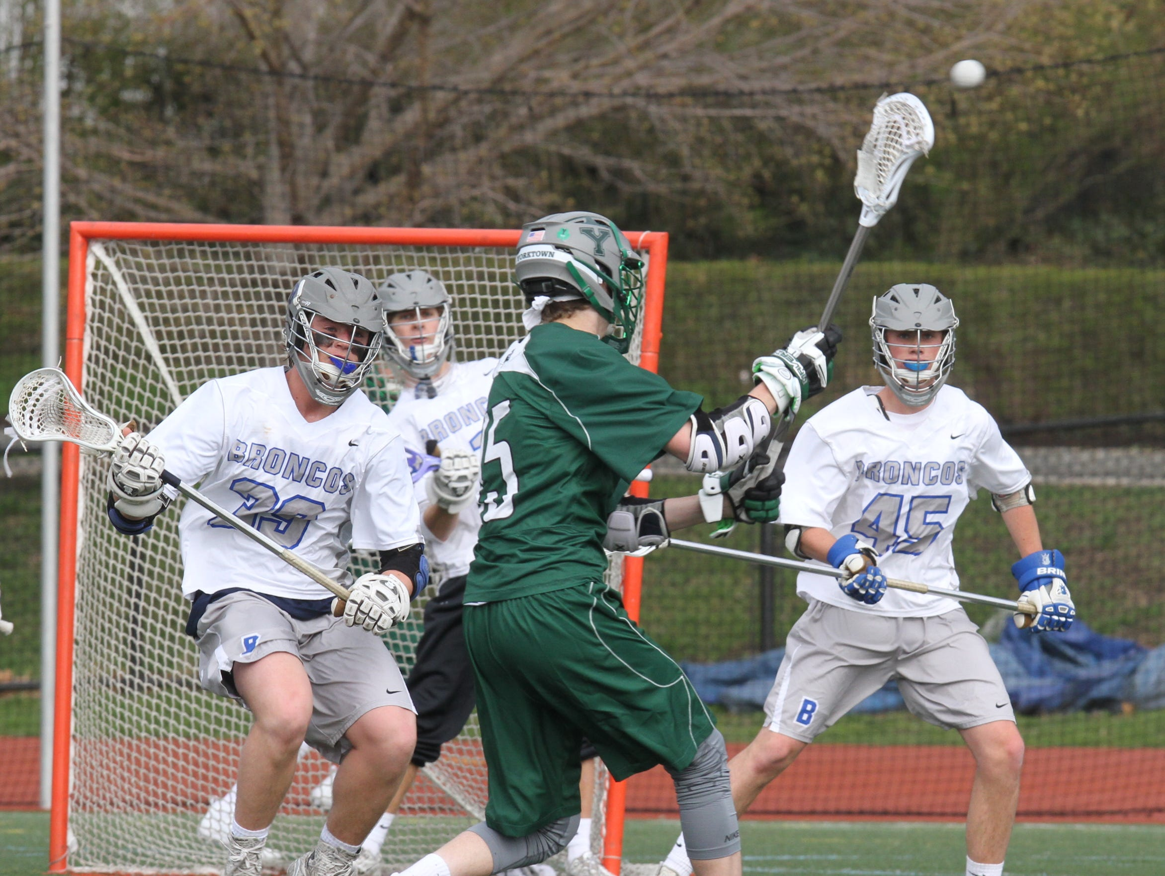 Yorktown's Kyle Casey (15) scores on the Bronxville defense during boys lacrosse at Bronxville High School on April 7, 2016. Yorktown defeats Bronxville 9-5.