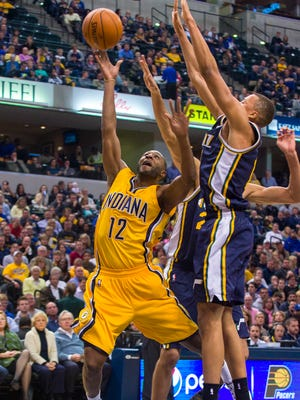 Indiana Pacers guard A.J. Price (12) puts up a shot from under the basket during first-half action. The Indiana Pacers hosted the Utah Jazz in NBA action, Monday, Nov. 10, 2014, at Bankers Life Fieldhouse.